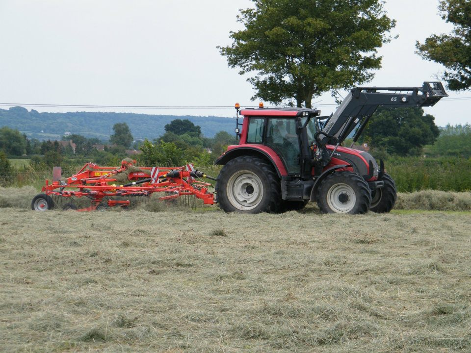 Red tractor, hay